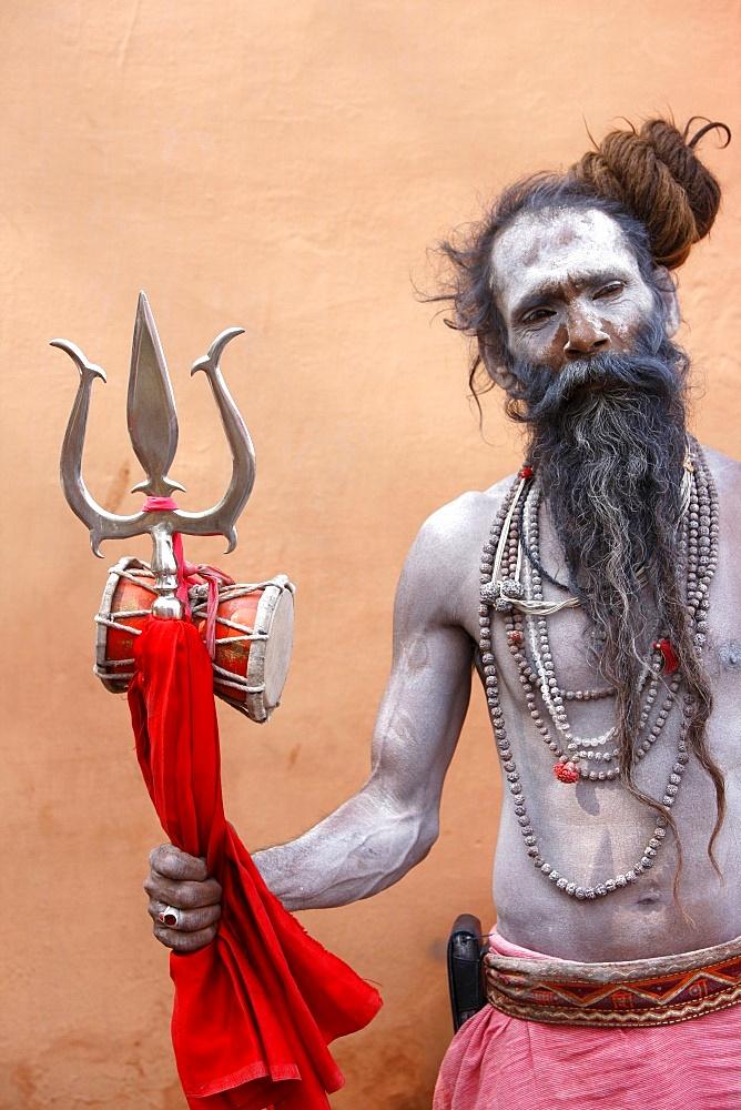 Sadhu with Shiva trident attending Haridwar Kumbh Mela, Haridwar, Uttarakhand, India, Asia