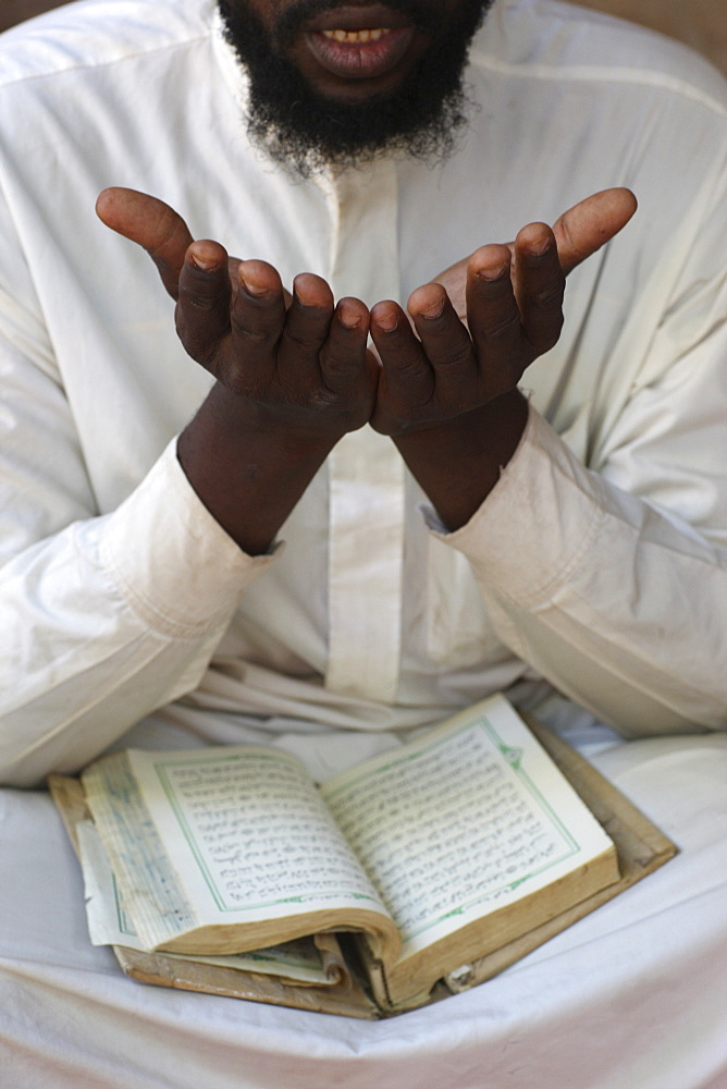 African man reading the Quran, Bamako, Mali, West Africa, Africa