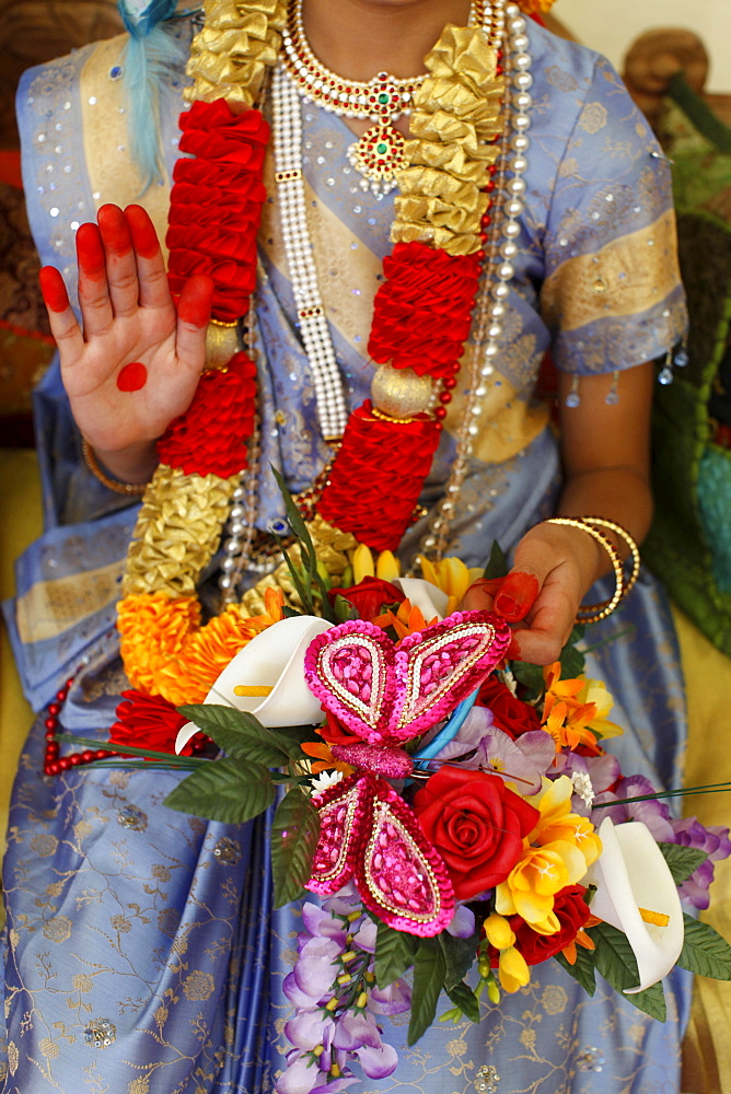Girl impersonating Hindu goddess Radha (Krishna's consort) at Janmashtami festival at Bhaktivedanta Manor ISKCON (Hare Krishna) temple, Watford, Hertfordshire, England, United Kingdom, Europe