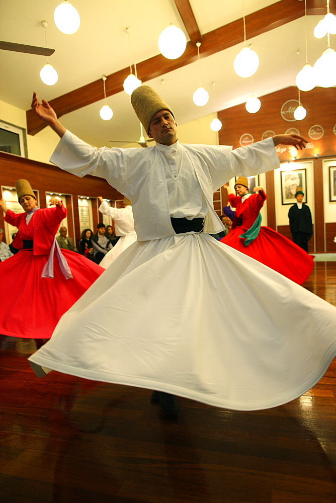 Whirling dervish performance in Silvrikapi Meylana cultural center, Istanbul, Turkey, Europe