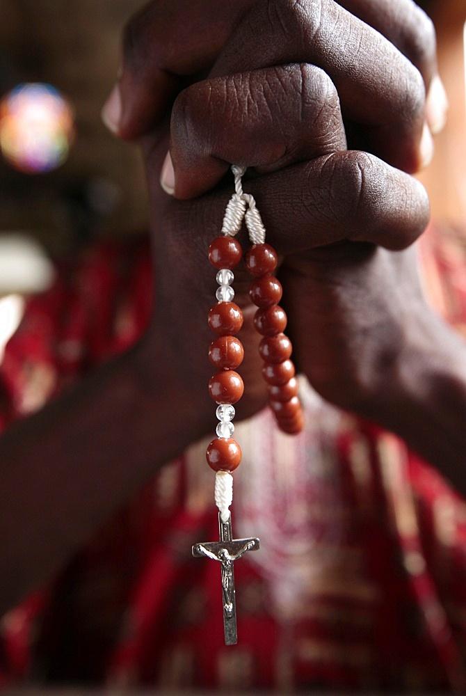 African man praying the rosary, Cotonou, Benin, West Africa, Africa