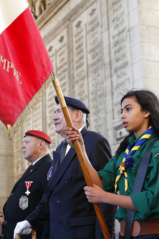 French Muslim girl scout and war veterans at the Arc de Triomphe, Paris, France, Europe