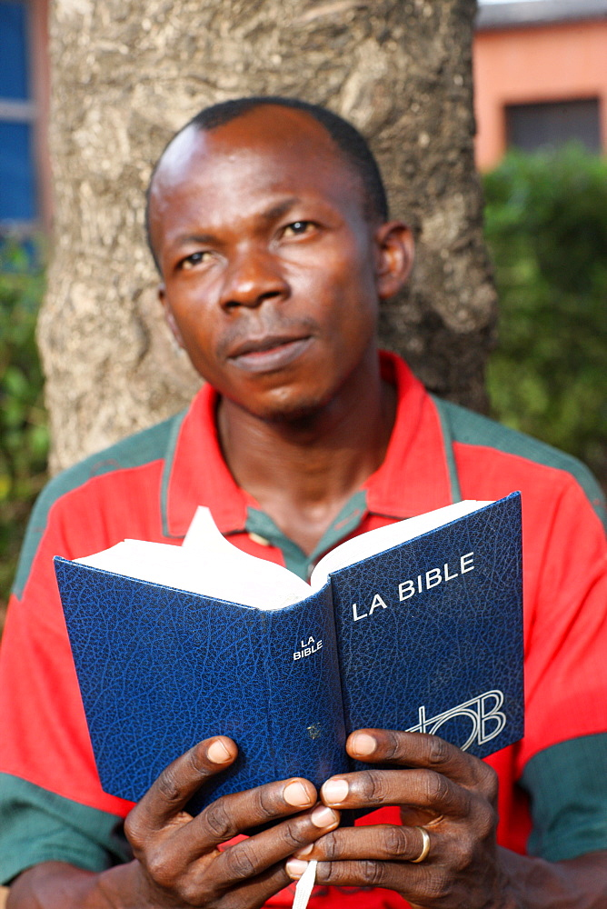 Man reading the Bible, Lome, Togo, West Africa, Africa