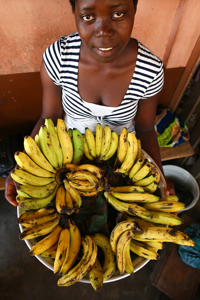 Girl selling bananas, Lome, Togo, West Africa, Africa