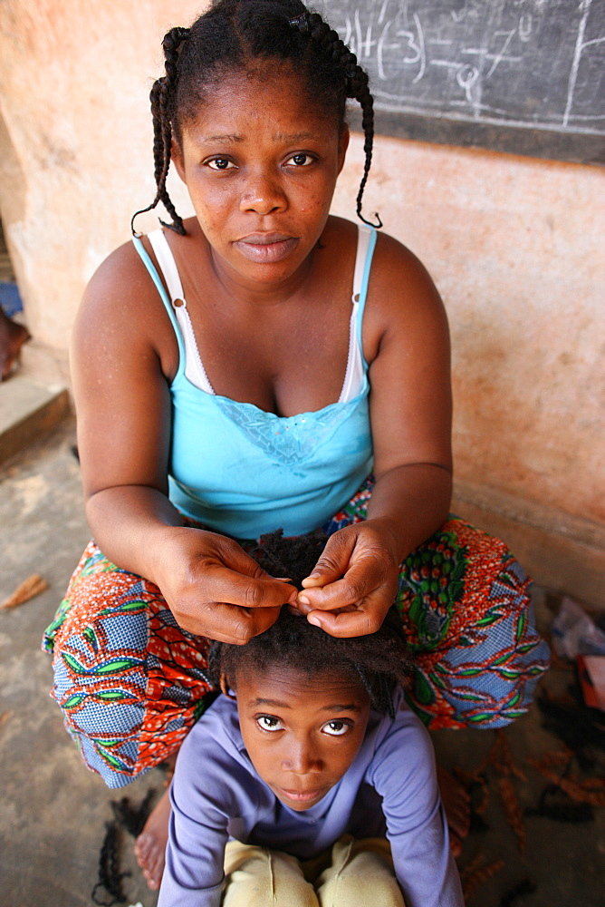Hairdresser at home, Lome, Togo, West Africa, Africa