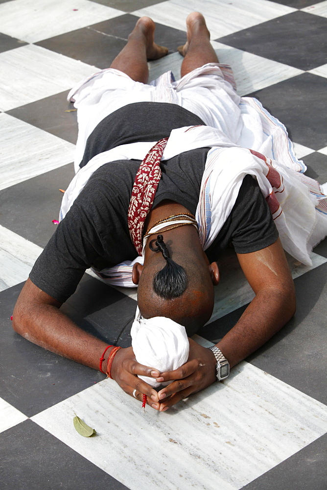 Hare Krishna devotee prostrating on the temple floor, Vrindavan, Uttar Pradesh, India, Asia