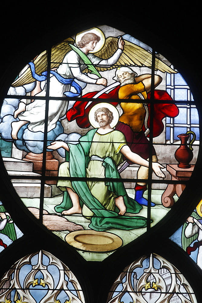 Depiction of the Martyrdom of St. John the Baptist in stained glass in Saint Severin church, Paris, France, Europe