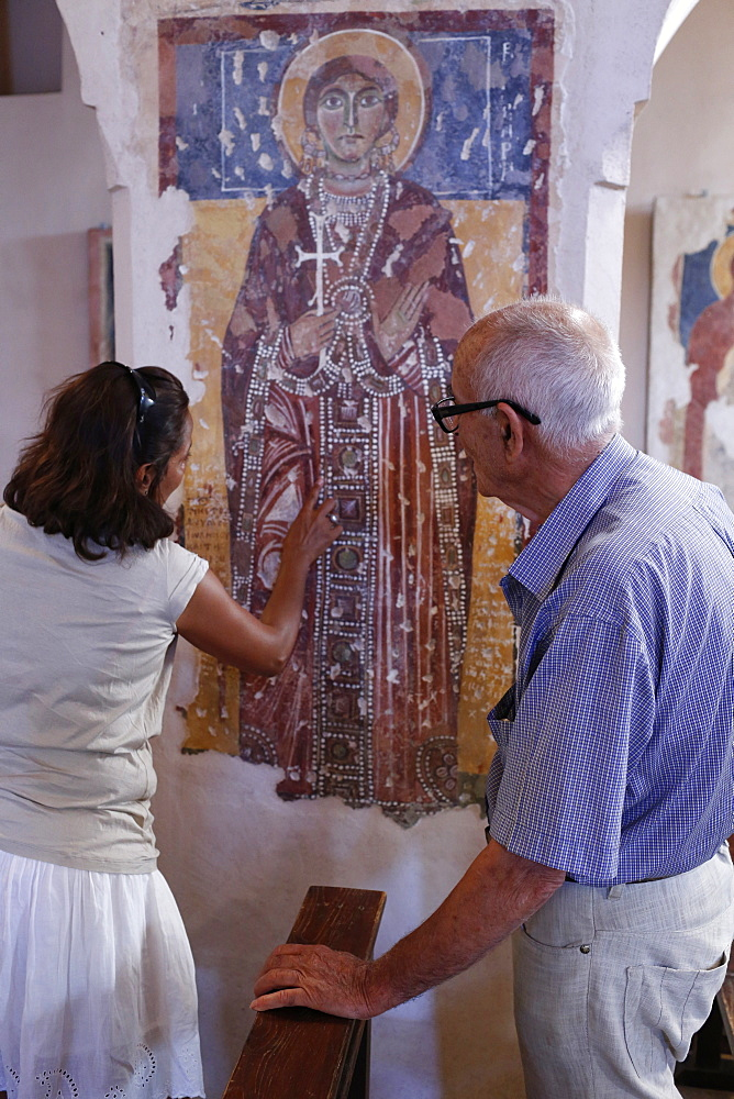 Tourist and guide in Santa Maria della Croce church, Casarana, Lecce, Apulia, Italy, Europe