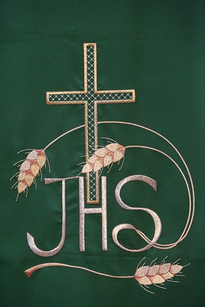 Jesus Christ Christogram or monogram in embroidery in Maria SS. Assunta church, Galatone, Lecce, Apulia, Italy, Europe