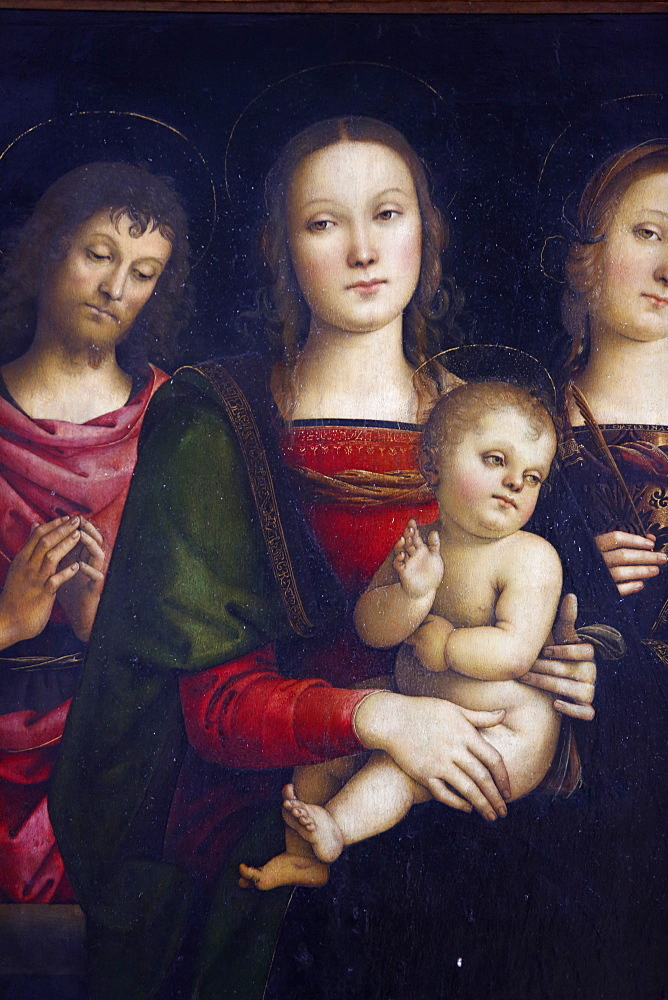 Virgin with child surrounded by St. John the baptist and St. Catherine by Pietro Vannucci painted in 1500, Paris, France, Europe