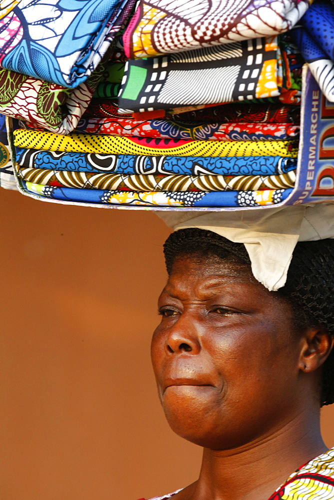 Street vendor selling African cloths, Lome, Togo, West Africa, Africa