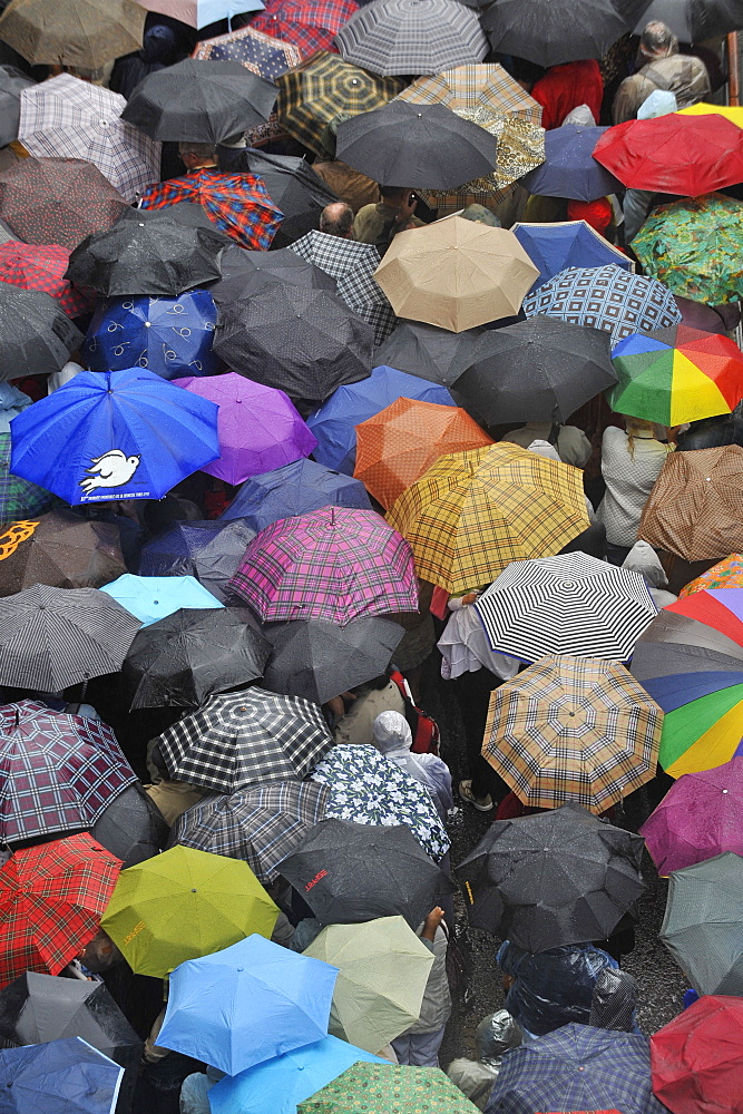 Pilgrims waiting in the rain for Pope Benedict XVI at Lourdes, Hautes Pyrenees, France, Europe - 809-643