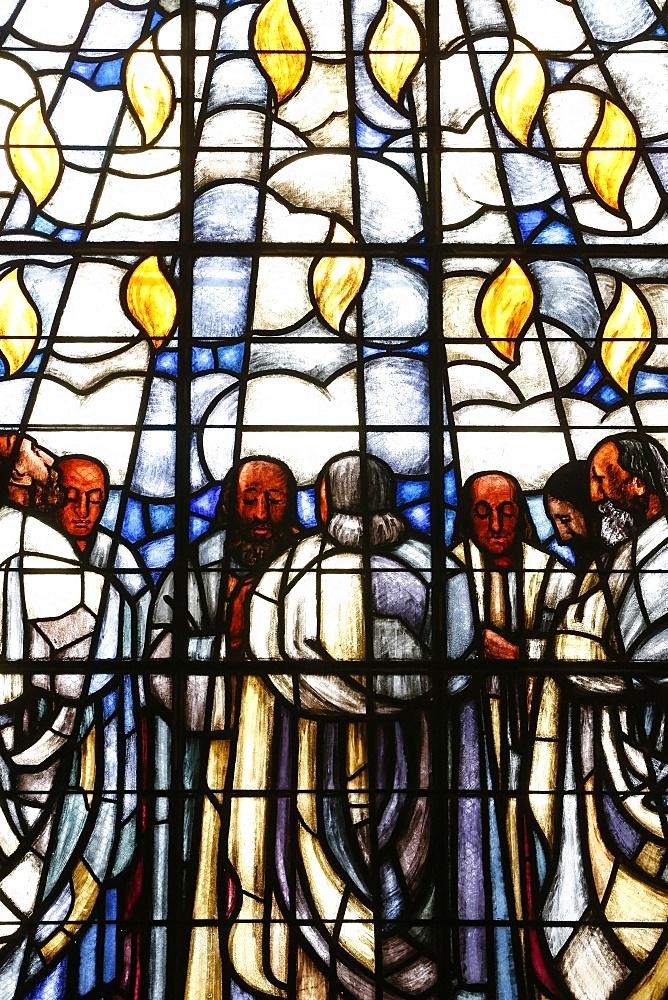 Stained glass of Whit Sunday, in La Madeleine Protestant church, Geneva, Switzerland, Europe
