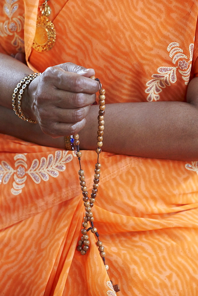 Tamil Catholic woman with rosary, Antony, Hauts-de-Seine, France, Europe