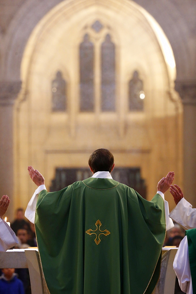 Eucharist, priest in Catholic Mass, Notre-Dame du Perpetuel Secours Basilica, Paris, France, Europe