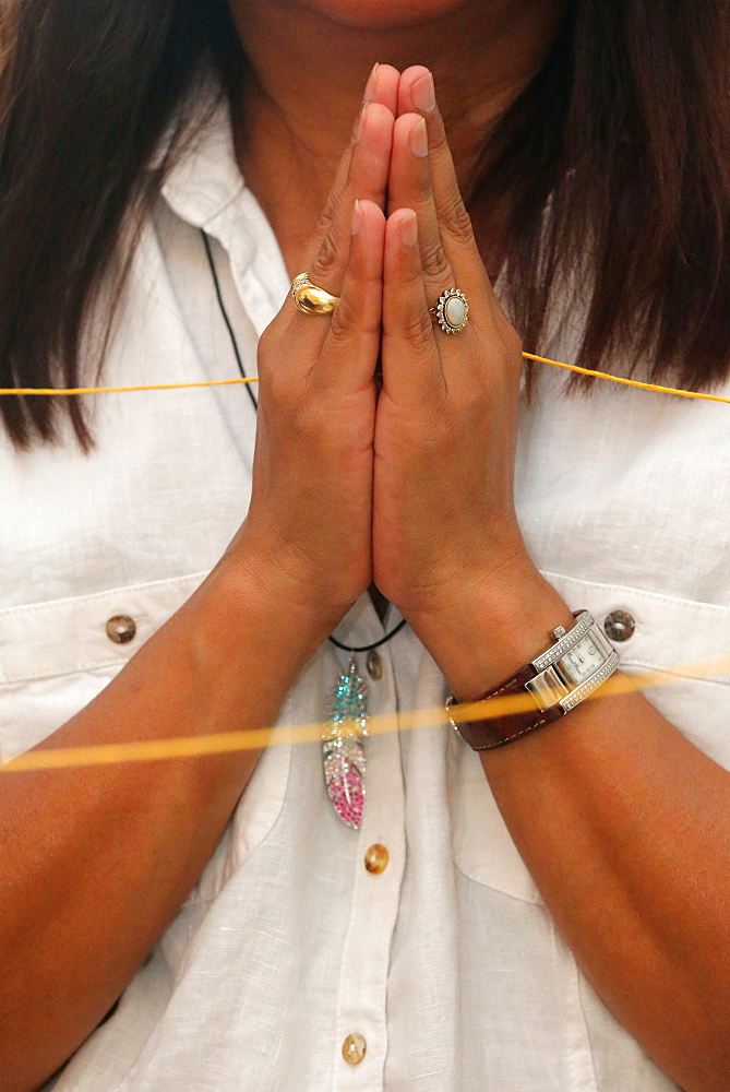 Sai-Sin (sacred thread) in use at a temple ceremony, International Buddhist Center of Geneva, Geneva, Switzerland, Europe