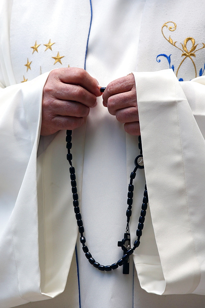 Hand-carved Roman Catholic rosary beads, priest praying The Mystery of the Holy Rosary, Haute Savoie, France, Europe