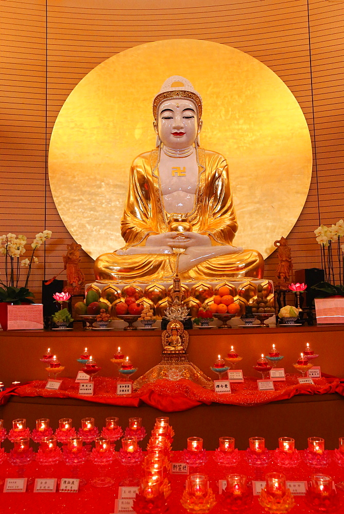 Buddha statue on main altar in Buddha Hall, Fo Guang Shan Temple, Geneva, Switzerland, Europe