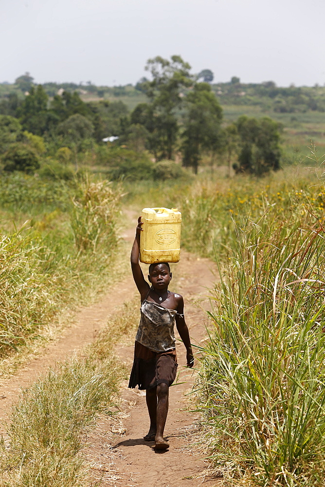 Ugandan child fetching water, Masindi, Uganda, Africa