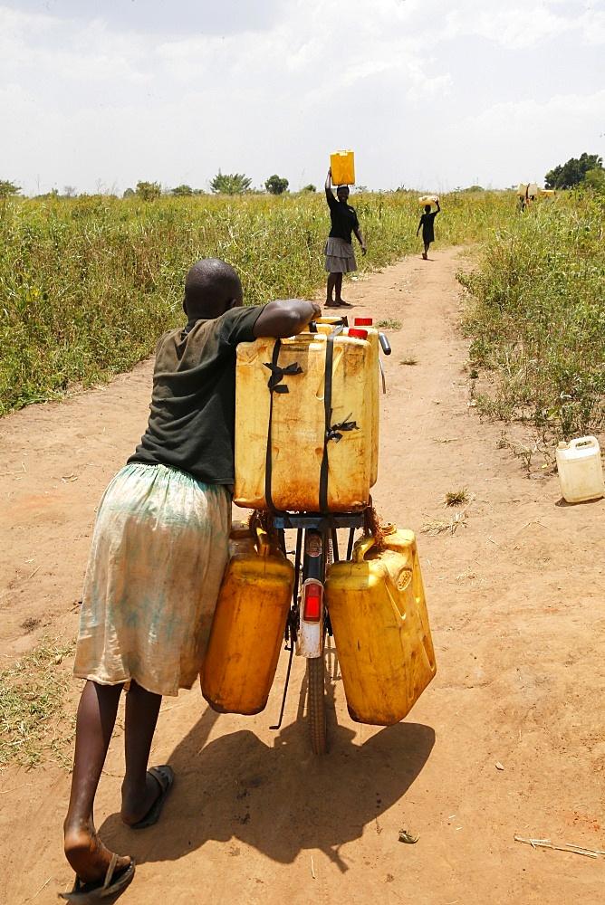 Water chore, Masindi, Uganda, Africa