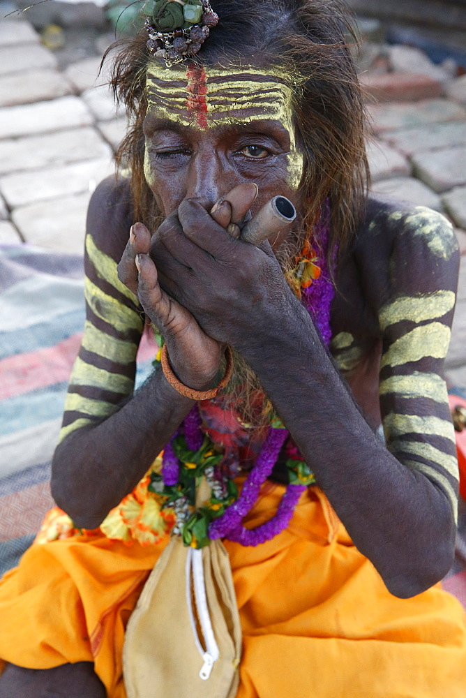 Indian sadhu smoking a chilum in Vrindavan, Uttar Pradesh, India, Asia