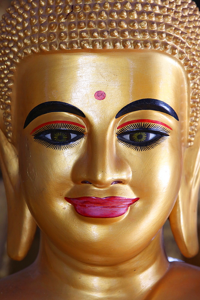 Close-up of a pink-lipped Buddha statue, Battambang, Cambodia, Indochina, Southeast Asia, Asia