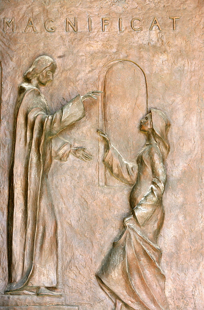 Sculpture depicting the Visitation with Mary and Elizabeth on the door of the Annunciation Basilica, Nazareth, Galilee, Israel, Middle East