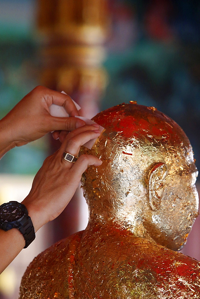 Faithful offering gold leaves, Khao Pansa celebration at Wat Ampharam, Hua Hin, Thailand, Southeast Asia, Asia