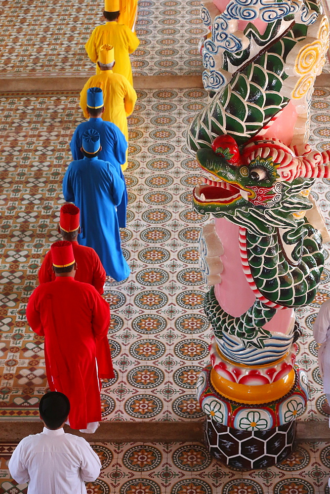 Priests and dragon column, Cao Dai Holy See Temple, Tay Ninh, Vietnam, Indochina, Southeast Asia, Asia
