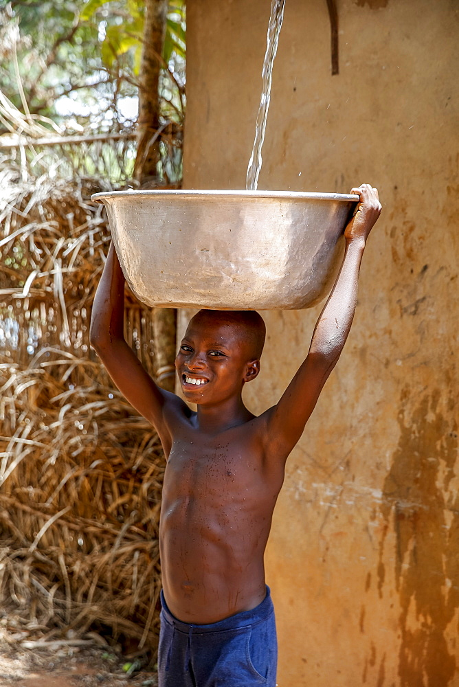 Collecting water in a Zou province village, Benin, West Africa, Africa