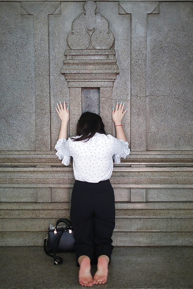 Worshipper praying at wall of the sanctuary, Mariamman Hindu Temple, Ho Chi Minh City, Vietnam, Indochina, Southeast Asia, Asia - 809-7458