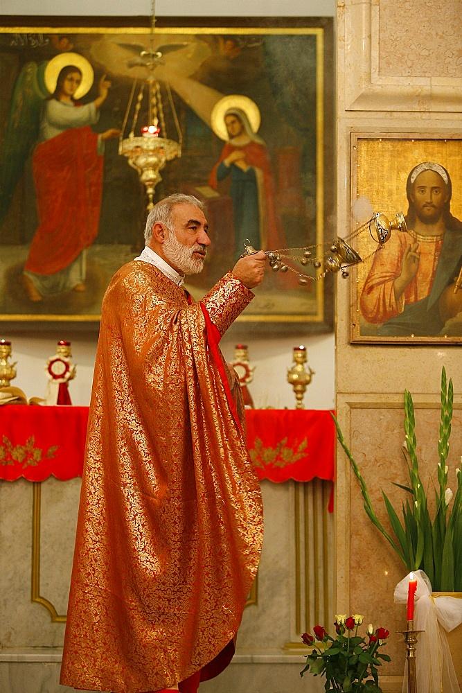 Melkite priest, Emile Shoufani, celebrating Mass in Nazareth, Nazareth, Galilee, Israel, Middle East