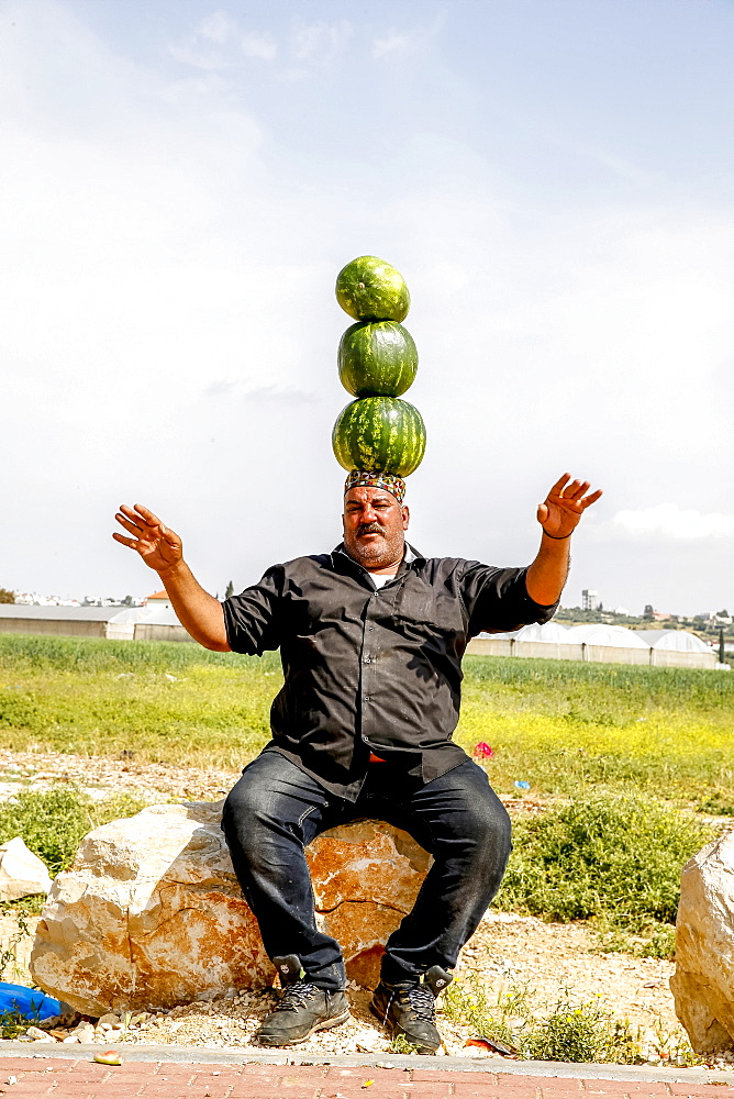 Palestinian selling watermelons at Al-Jalameh checkpoint on Israel-Palestine border, Palestine, Middle East - 809-7622