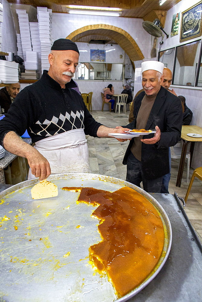 The most famous knaffieh (Palestinian cheese pastry) shop in Nablus, West Bank, Palestine, Middle East - 809-7625