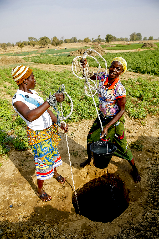 Women fetching water in Namong, Tone district, Togo.