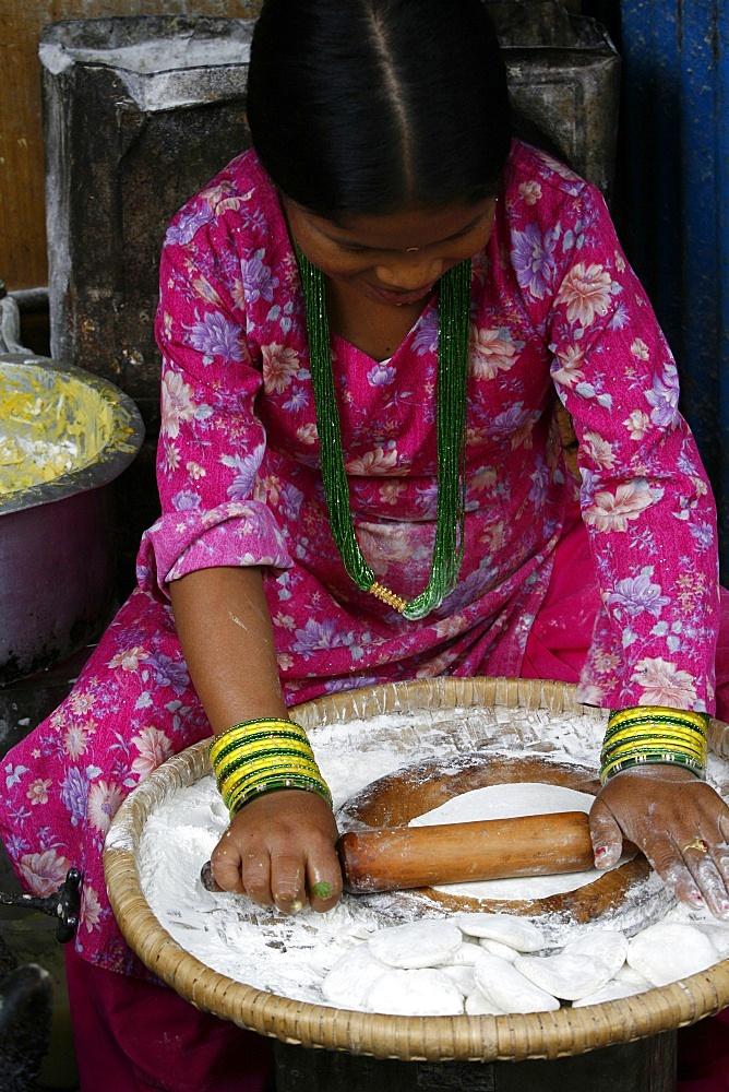 Woman making chapati, Dakshin Kali, Nepal, Asia