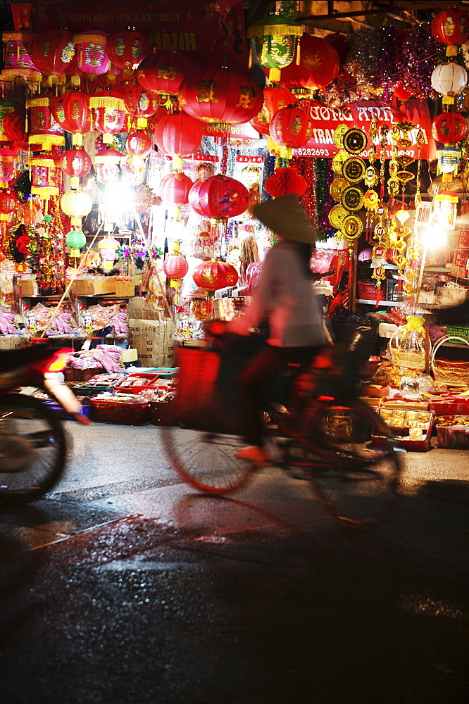 Cyclist in front of lantern stall, Hanoi, Vietnam, Indochina, Southeast Asia, Asia - 812-159