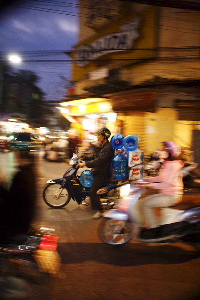Motor cyclist carrying water bottles in traffic, Vietnam, Indochina, Southeast Asia, Asia - 812-160