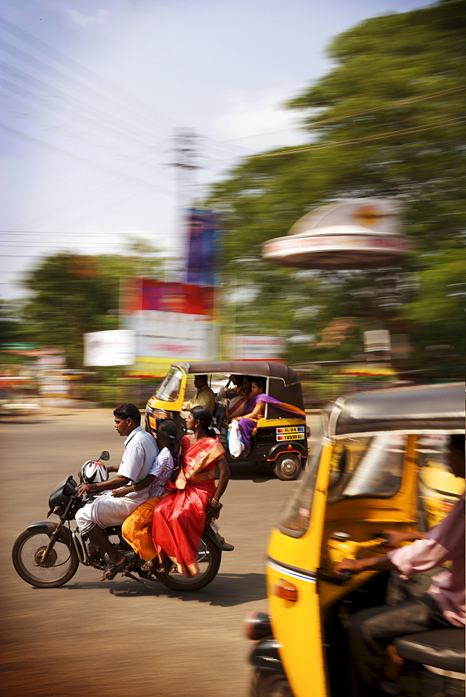 Traffic with colourful locals on motorbikes and tuk tuks, Kerala, India, Asia - 812-224