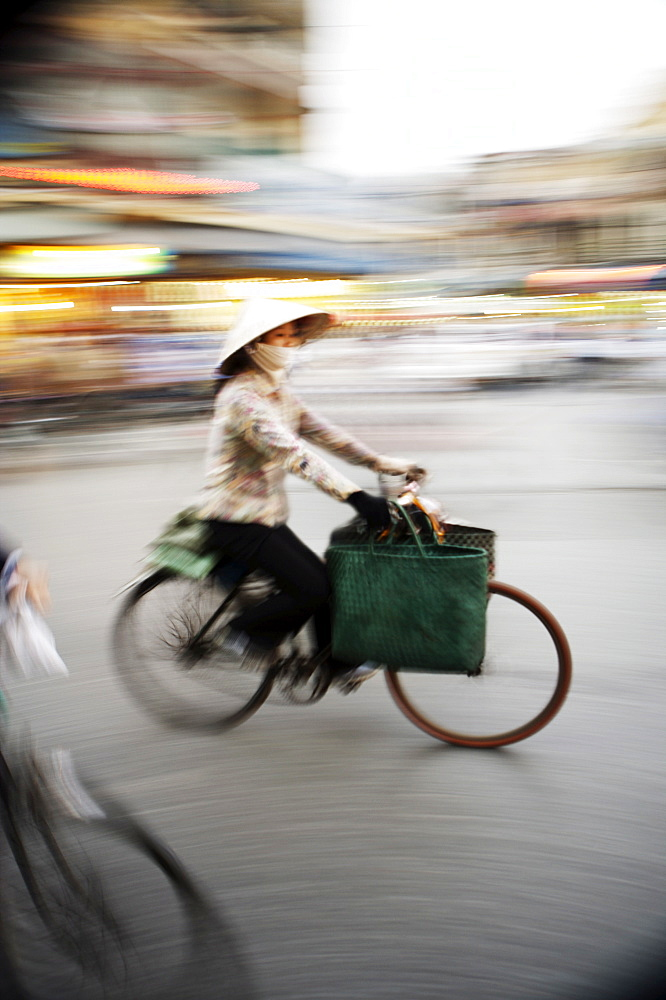 Lady on bicycle with shopping, Hanoi, Vietnam, Indochina, Southeast Asia, Asia