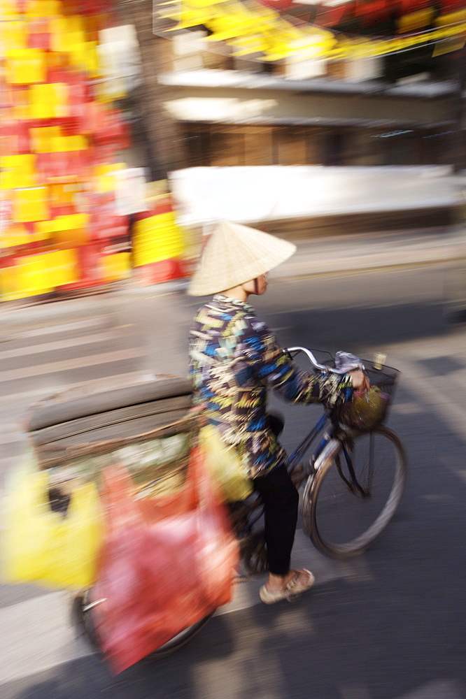 Man on bike at Tet festival (Vietnamese New Year), Ho Chi Minh city, Vietnam, Indochina, Southeast Asia, Asia - 812-71