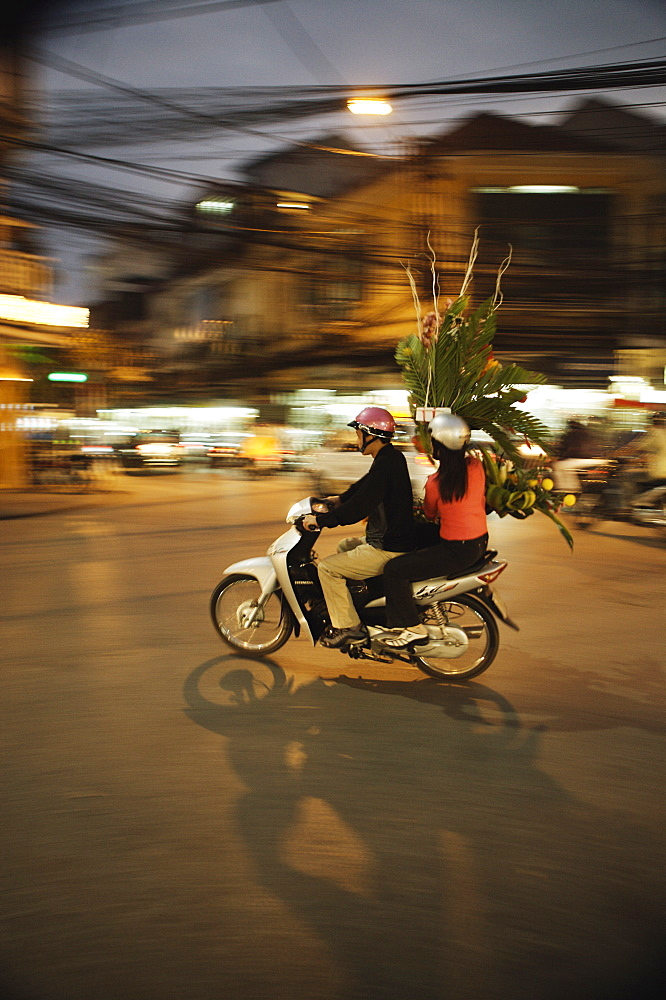Couple on moped carrying floral display, Hanoi, Vietnam, Indochina, Southeast Asia, Asia - 812-75
