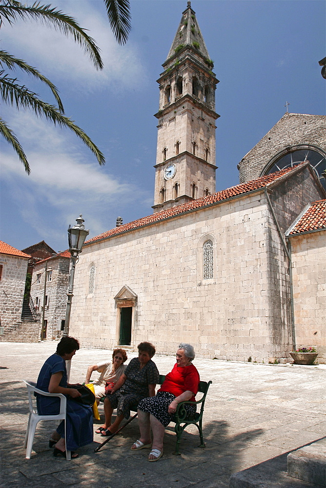 Women in the Church Square in the village of Perast, Montenegro, Europe
