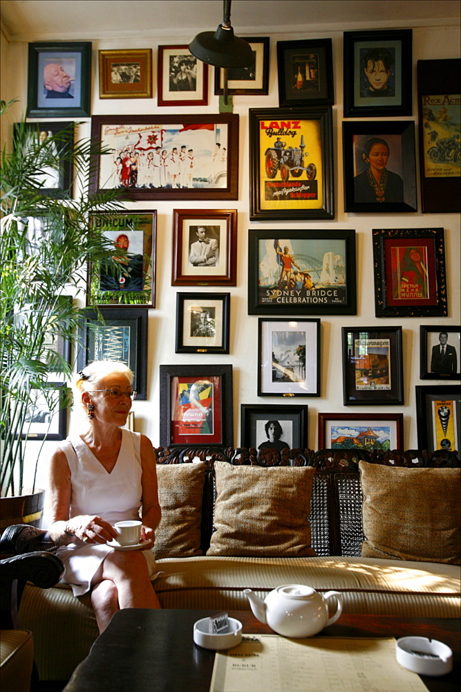 Woman having a tea in a lounge of the Batavia Cafe, the most famous colonial place of Jakarta, Java, Indonesia, Southeast Asia, Asia
