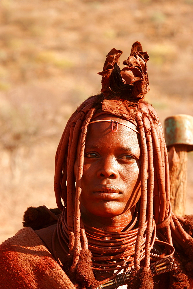 Young Himba woman wearing wedding finery, near to the Epupa falls on the border with Angola, Namibia, Africa