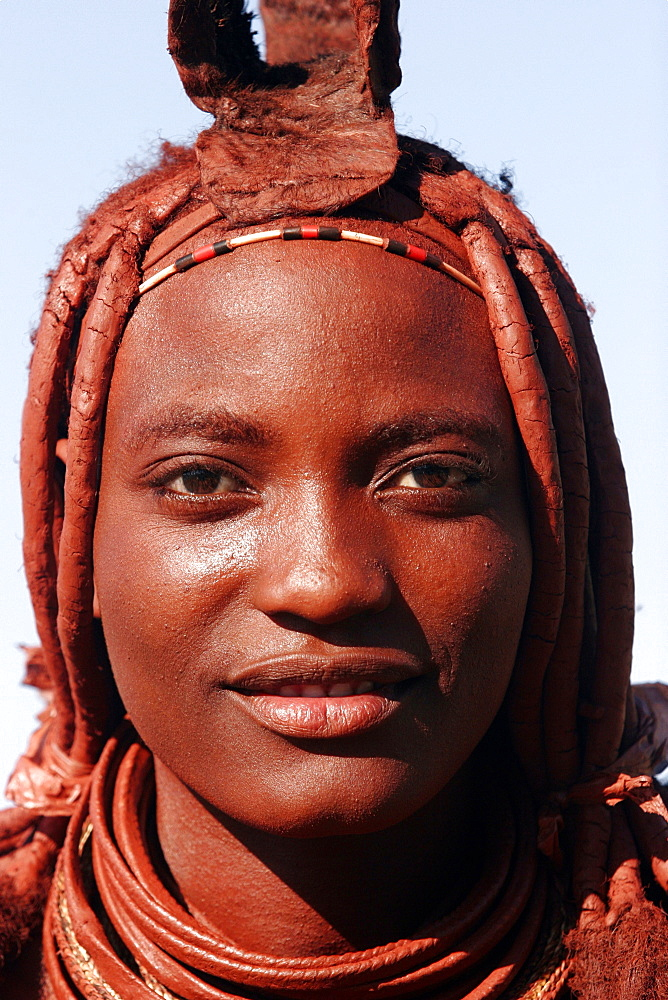 Young woman Himba in the area of Kunene river, on the border with Angola, Namibia, Africa