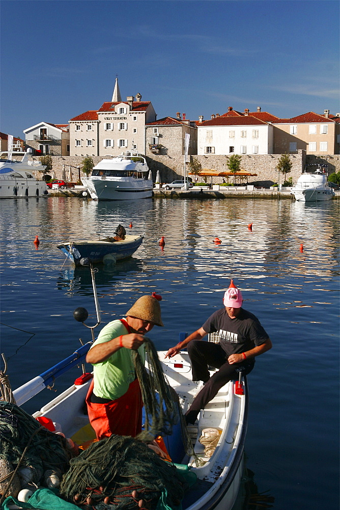 Fishermen in front of the small city of Budva, Montenegro, Europe