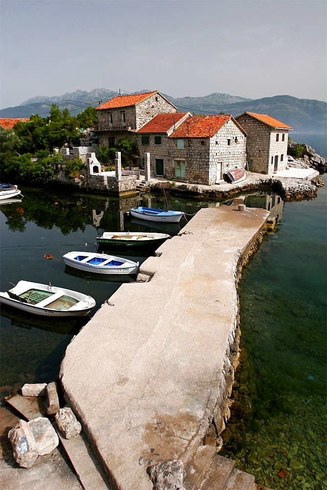 Typical houses with tiled roofs and stone walls on the Gulf of Kotor, Montenegro, Europe