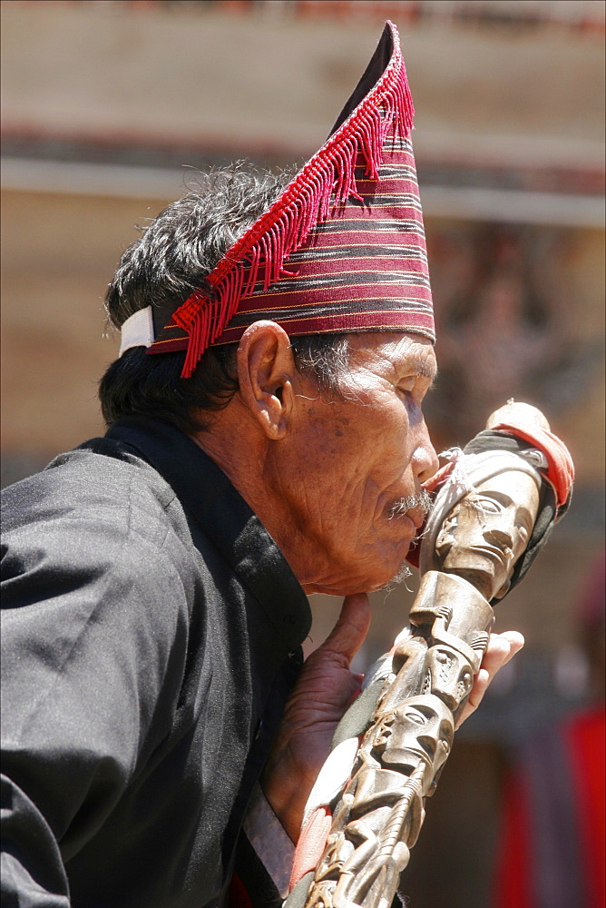Man at a Batak dance show in Samosir, Lake Toba, Sumatra, Indonesia, Southeast Asia, Asia