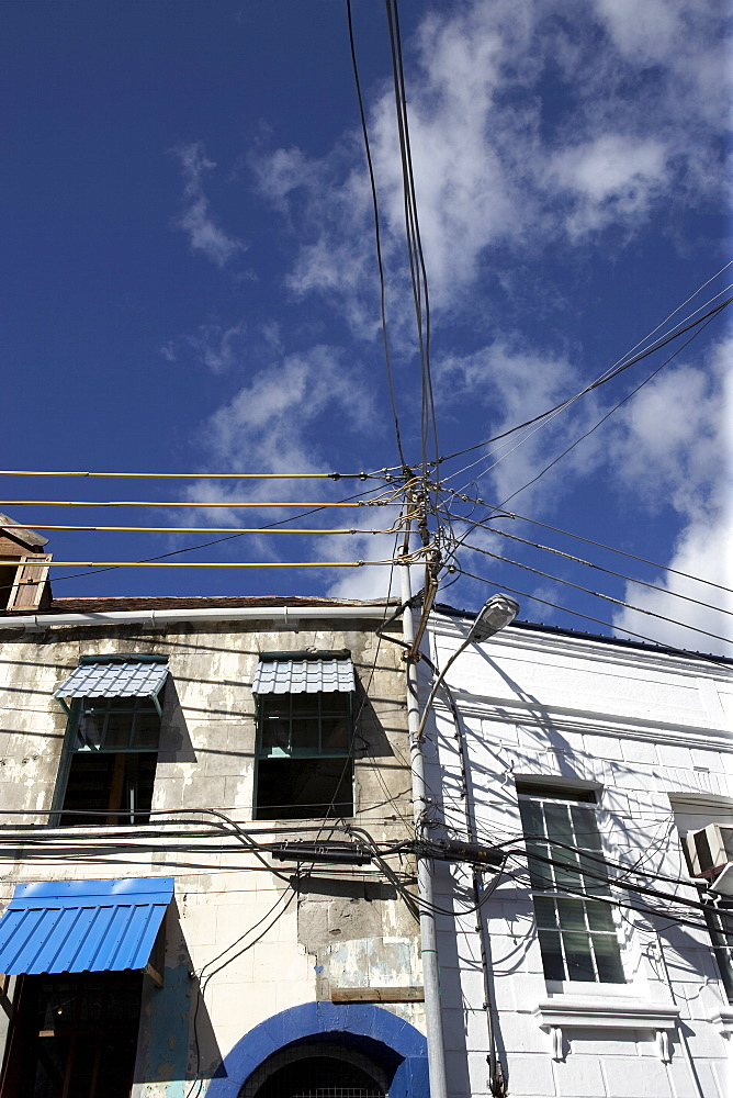 Wormeye view of upper stories of traditional housing and sky, Grenada, Windward Islands, West Indies, Caribbean, Central America